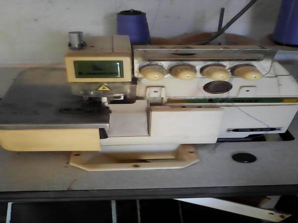 ITEM Nº: 12; Máquina de costura interlock industrial em Itaúna/MG.; Marca Lanmax, TYPE LM